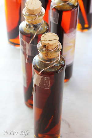 Homemade Vanilla Extract, bottles prepared with bakers twine for wax dipping