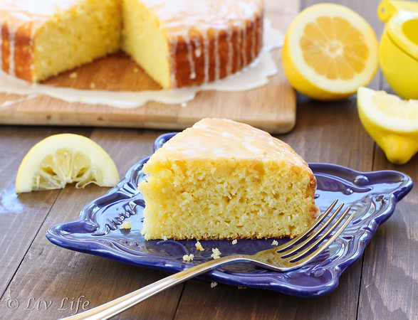 Lemon Olive Oil Cake slice on blue plate