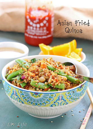 Asian Fried Quinoa in blue bowl with sriracha and tea