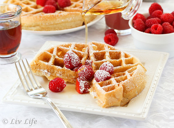 Yeasted Belgian Waffles with syrup and a fork