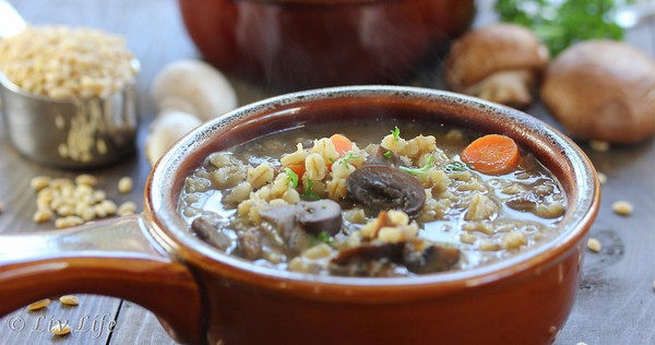 Beef and Barley Soup with Mushrooms in a brown bowl